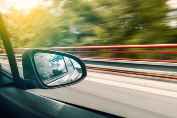 View through the window of a vehicle driving at high speed.