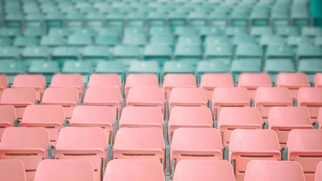 Empty coloured seats in a stadium.
