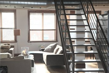 The inside of an apartment with a staircase.