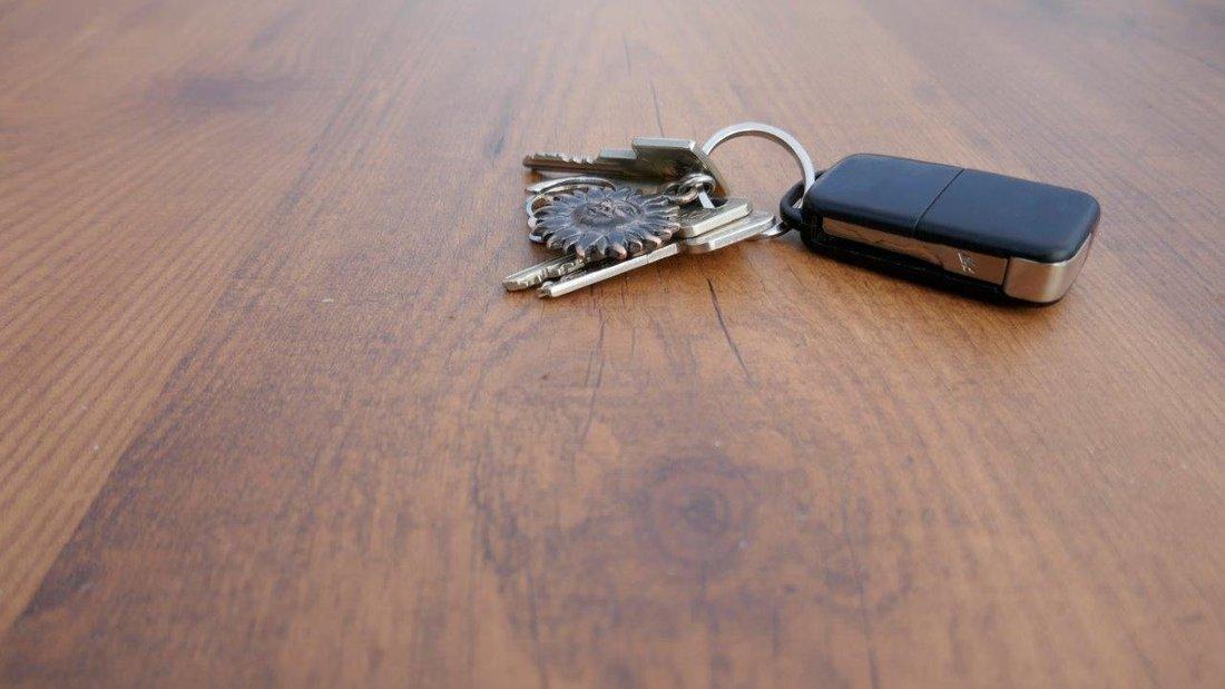 car keys on a table